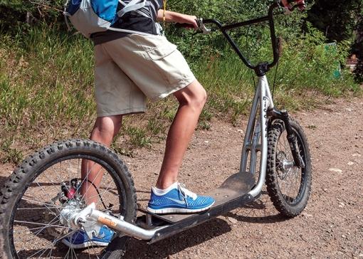 Boy rides a Diggler Mountain Scooter, Purgatory at Durango Mountain Resort, Durango, Colorado.